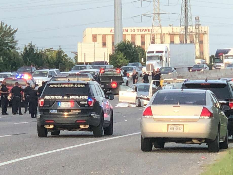 Houston Police investigate the scene on I-10 east near Mercury Dr, after two people were shot and killed on the freeway. The shooter is still on the loose, Thursday August 9, 2019, in Houston. Photo: Karen Warren/Houston Chronicle