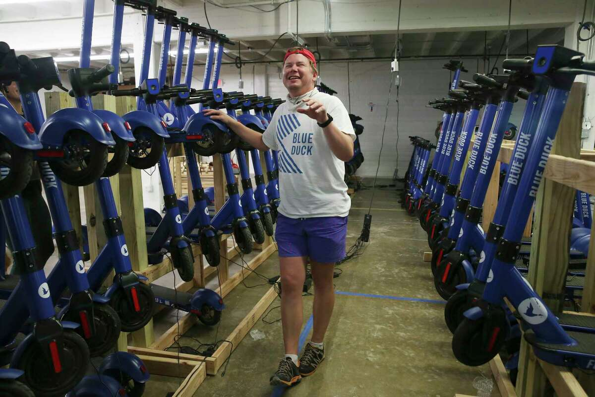 Blue Duck CEO Eric Bell brainstorms laughs while working at the company's warehouse, Monday, May 6, 2019. Blue Duck is a local company that offers scooter rentals in San Antonio.