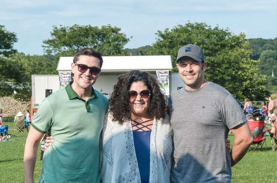 Jimmy Tickey, Nicole Heriot-Mikula and Michael Skrtic, founders of Celebrate Shelton, were all smiles after the Downtown Sounds event last August. The three-week summer concert and food truck series once again enjoyed strong attendance. Photo: Chris Sidoruk. / For Hearst Connecticut Media / Connecticut Post