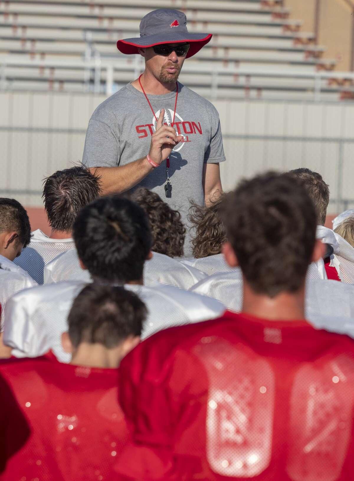 Stanton head coach Cody Hogan talks with his players 08/08/19 after practice. Tim Fischer/Reporter-Telegram