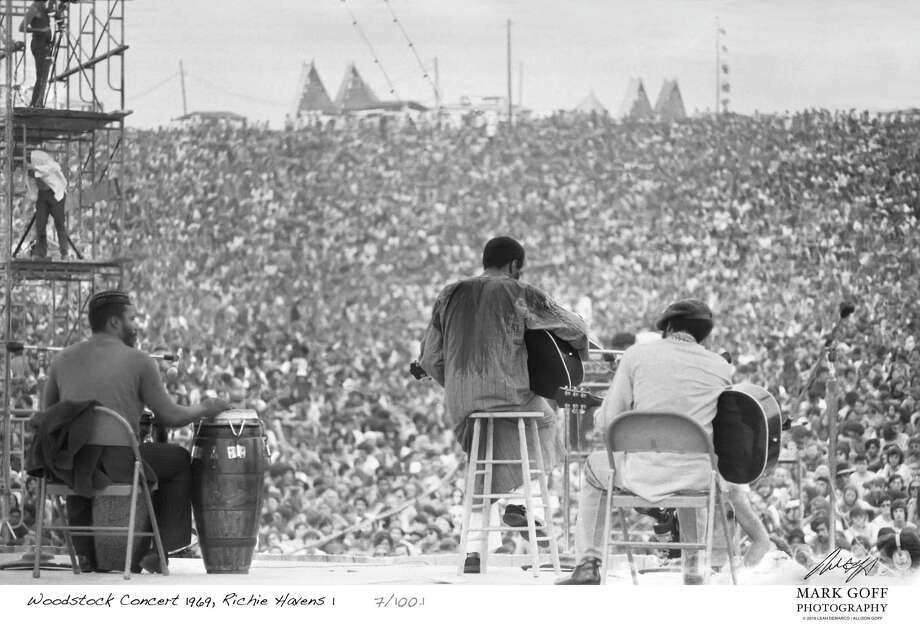 This August, 1969 photo shows Richie Havens as he performs during Woodstock in Bethel, N.Y. The photo is only one of hundreds made by photographer Mark Goff who, at the time, worked for an underground newspaper in Milwaukee, Wis. Some were published, but the negatives were filed away at his Milwaukee home and barely mentioned as Goff raised two daughters, changed careers and, last November, died of cancer. Dozens of Goff's Woodstock shots are being displayed 50 years later. (Mark Goff Photography, Leah Demarco/Allison Goff via AP) Photo: Mark Goff / Leah Goff Demarco and Allison Goff