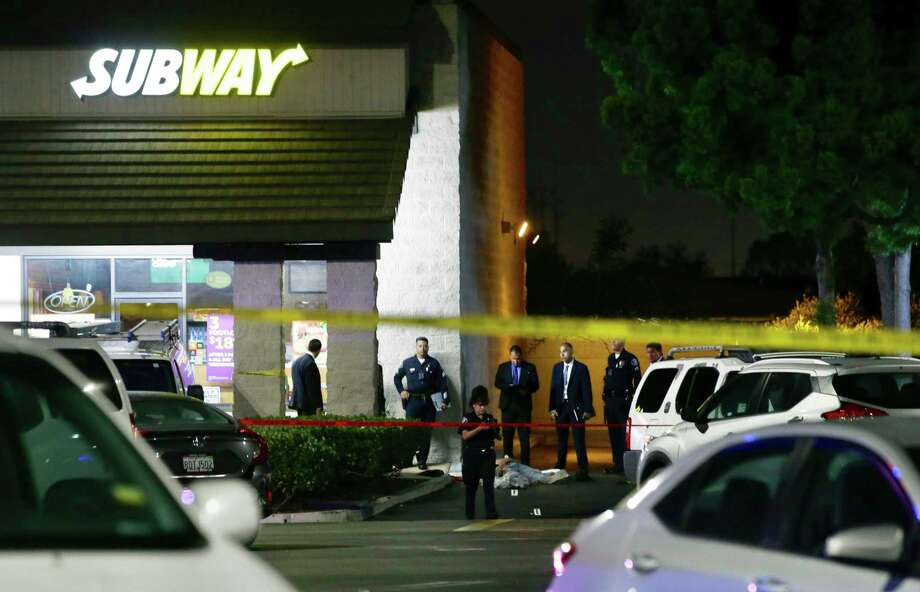 EDS NOTE: GRAPHIC CONTENT - Police work the scene of a stabbing in Santa Ana, Calif., Wednesday, Aug. 7, 2019. A man killed multiple people and wounded others in a string of robberies and stabbings in California's Orange County before he was arrested, police said Wednesday. (AP Photo/Alex Gallardo) Photo: Alex Gallardo / AP FR170211