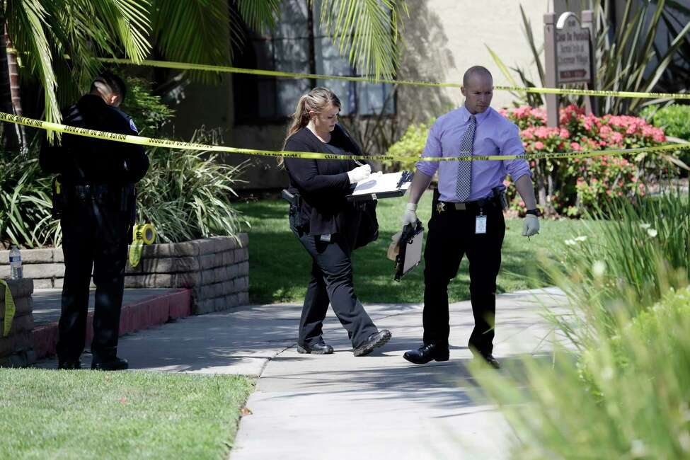 Police investigate the scene where two people were stabbed to death Thursday, Aug. 8, 2019, in Garden Grove, Calif. A man killed four people and wounded two in a string of robberies and stabbings in California's Orange County before he was arrested, police said Wednesday. (AP Photo/Marcio Jose Sanchez)