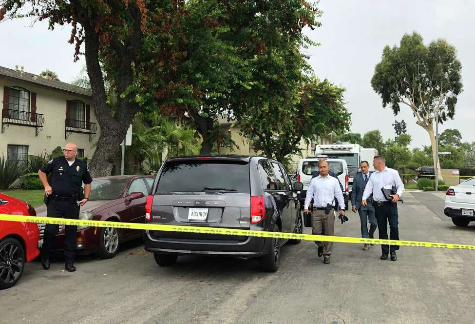 Garden Grove police leave the scene of a stabbing in Garden Grove, Calif., Thursday., Aug. 8, 2019. A man killed four people and wounded two in a string of robberies and stabbings in California's Orange County before he was arrested, police said Wednesday. (AP Photo/Amy Taxin)
