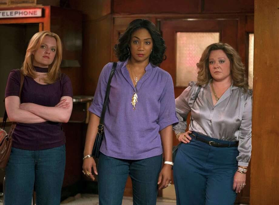 """This image released by Warner Bros. Pictures shows, from left, Elisabeth Moss, Tiffany Haddish and Melissa McCarthy in a scene from """"The Kitchen."""" (Alison Cohen Rosa/Warner Bros. Pictures via AP) Photo: Alison Cohen Rosa / © 2018 Warner Bros. Entertainment Inc."""