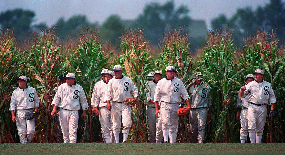 "RETRANSMISSION TO CORRECT DATE OF PHOTO TO JUNE 22, 1997 - FILE - In this June 22, 1997 undated file photo, people portraying ghost players emerge from a cornfield as they reenact a scene from the movie ""Field of Dreams"" at the movie site in Dyersville, Iowa. The Chicago White Sox will play a game against the New York Yankees next August at the site in Iowa where the movie ""Field of Dreams"" was filmed. Major League Baseball announced Thursday, Aug. 8, 2019, that the White Sox will play host to the Yankees in Dyersville, Iowa, on Aug. 13. (AP Photo/Charlie Neibergall, File) Photo: CHARLIE NEIBERGALL / Copyright 2019 The Associated Press. All rights reserved."