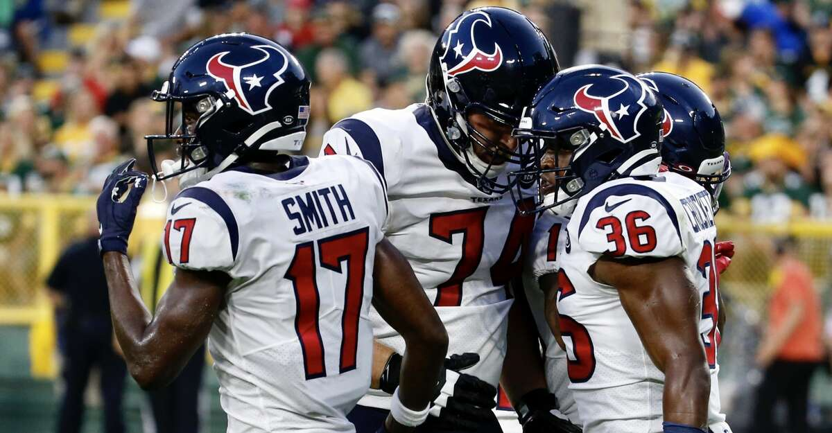 Houston Texans running back Damarea Crockett (36) celebrates his touchdown run with teammates Byncint Smith (17) and Max Scharping (74) during an NFL preseason football game against the Green Bay Packers at Lambeau Field in Thursday, Aug. 8, 2019, in Green Bay, Wis.