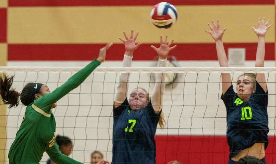 College Park senior Grace Fanset (17) and freshman Donyah Cosie (10) jump to block a kill during the Katy/Cy-Fair Volleyball Classic on Thursday, August 8, 2019 at Cypress Woods High School. Photo: Cody Bahn, Houston Chronicle / Staff Photographer / © 2019 Houston Chronicle