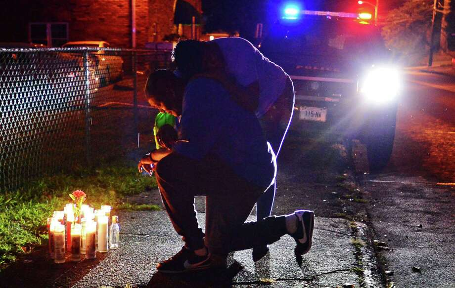 Family members gather to hold a vigil for the stabbing victim at 39 Faifield Ave. Thursday August 8, 2019, in Norwalk, Conn. Photo: Erik Trautmann / Hearst Connecticut Media / Norwalk Hour