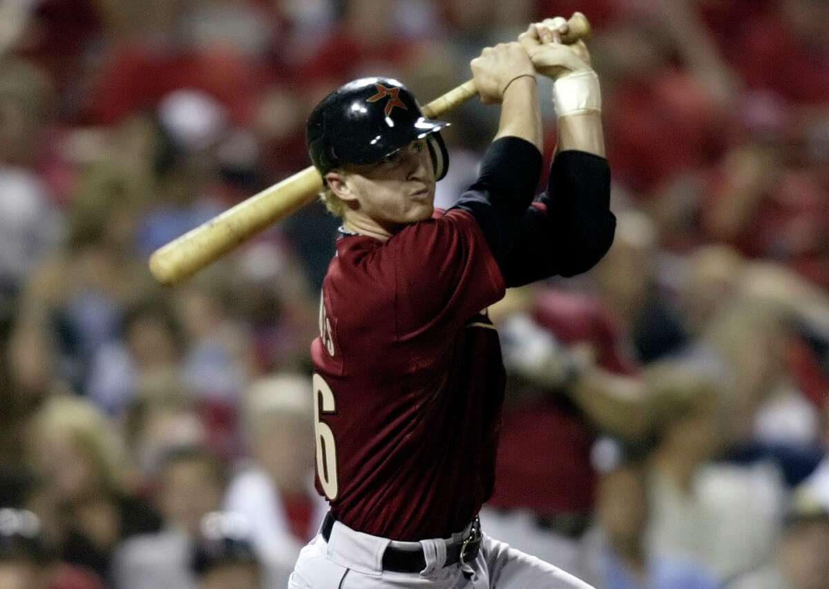 J.R. Towles drives in a run on a sixth-inning single, part of his eight-RBI night in the Astros' 18-1 rout of the Cardinals at Busch Stadium on Sept. 20, 2007.