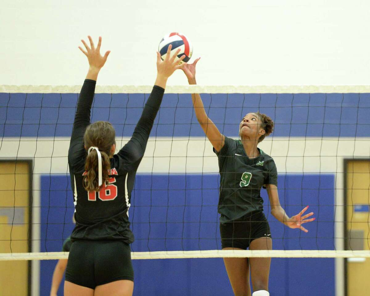 Aysia Nunn (9) of Mayde Creek attempts to tip the ball past Rachel Pringle (16) of Austin during the second set of a volleyball match between the Mayde Creek Rams and the Ft Bend Austin Bulldogs on Thursday, August 8, 2019 at Taylor HS, Katy, TX.