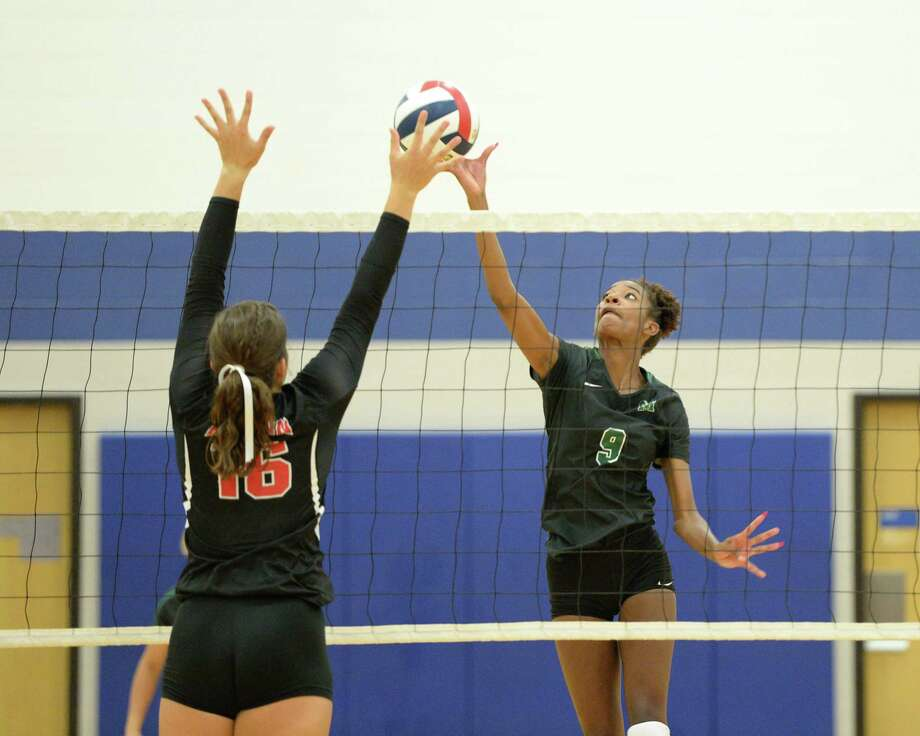 Aysia Nunn (9) of Mayde Creek attempts to tip the ball past Rachel Pringle (16) of Austin during the second set of a volleyball match between the Mayde Creek Rams and the Ft Bend Austin Bulldogs on Thursday, August 8, 2019 at Taylor HS, Katy, TX. Photo: Craig Moseley, Staff / Staff Photographer / ©2018 Houston Chronicle