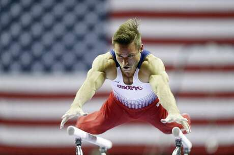 Sam Mikulak had the high scores on floor exercise, high bar and uneven bars at the U.S. gymnastics championships on Thursday.