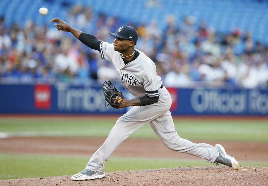 TORONTO, ONTARIO - AUGUST 8: Domingo German #55 of the New York Yankees pitches to the New York Yankees in the first inning at the Rogers Centre on August 8, 2019 in Toronto, Canada. (Photo by Mark Blinch/Getty Images) Photo: Mark Blinch / 2019 Getty Images