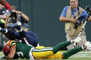 Green Bay Packers Equanimeous St. Brown (19) falls on a muffed punt reception by Houston Texans punt returner Keke Coutee that resulted in a Packers touchdown during an NFL preseason football game against the Green Bay Packers at Lambeau Field in Thursday, Aug. 8, 2019, in Green Bay, Wis.