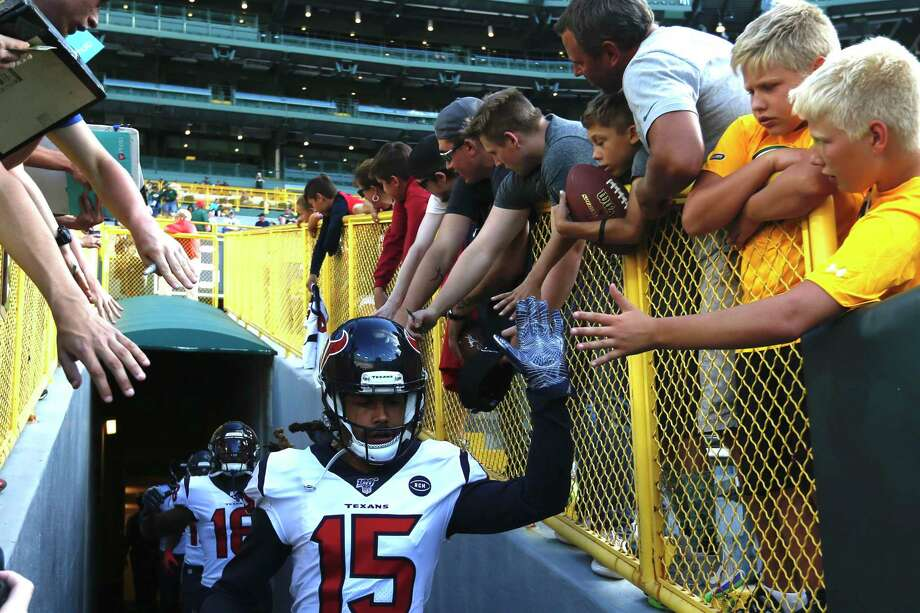 Houston Texans wise receiver Will Fuller high fives fans as he runs into the field before an NFL preseason football game against the Green Bay Packers at Lambeau Field in Thursday, Aug. 8, 2019, in Green Bay, Wis. Photo: Brett Coomer, Houston Chronicle / Staff Photographer / © 2019 Houston Chronicle