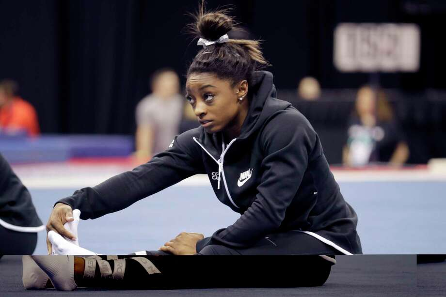 Simone Biles stretches during practice for the U.S. Gymnastics Championships Wednesday, Aug. 7, 2019, in Kansas City, Mo. (AP Photo/Charlie Riedel) Photo: Charlie Riedel / Copyright 2019 The Associated Press. All rights reserved.
