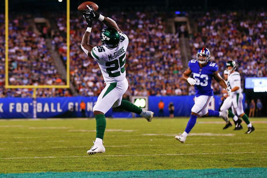 New York Jets running back Elijah McGuire (25) catches a pass for a touchdown in front of New York Giants' Oshane Ximines (53) during the first half of a preseason NFL football game Thursday, Aug. 8, 2019, in East Rutherford, N.J. (AP Photo/Adam Hunger) Photo: Adam Hunger / Copyright 2019 The Associated Press. All rights reserved