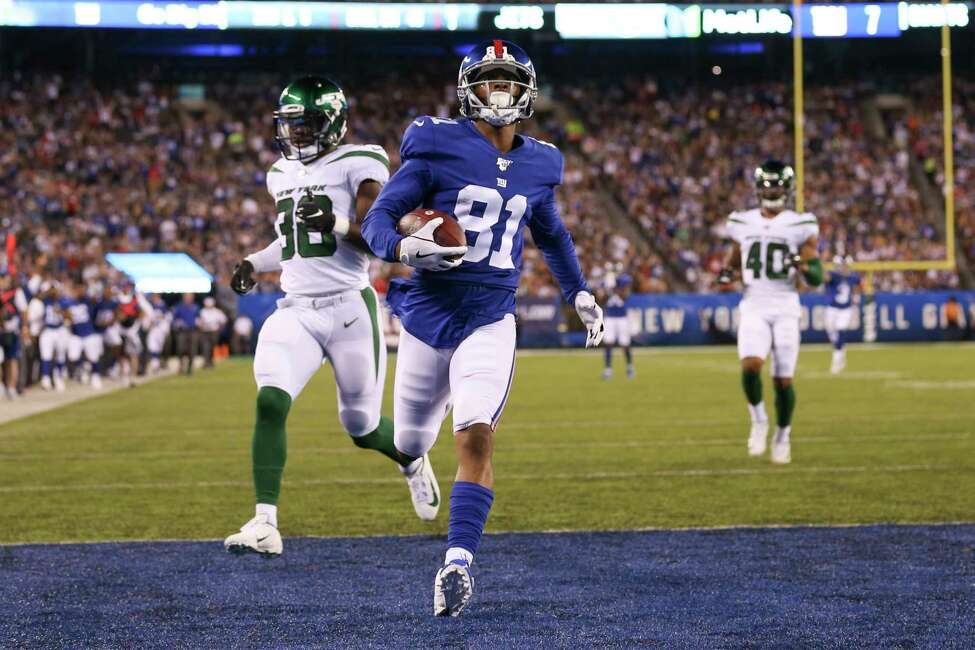 New York Giants' Russell Shepard (81) scores a touchdown as New York Jets' Brandon Bryant (38) and Kyron Brown (40) trail during the first half of a preseason NFL football game Thursday, Aug. 8, 2019, in East Rutherford, N.J. (AP Photo/Michael Owens)