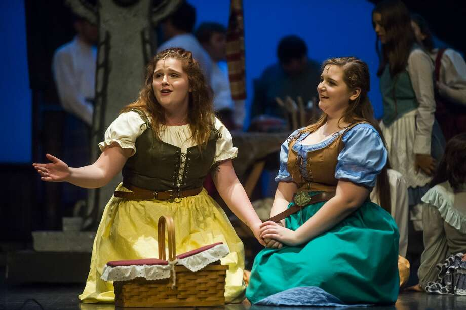 """Ella McKane-Wright in the role of Fiona MacLaren, left, and Kennedy Danner in the role of Meg Brockie, right, act out a scene during a dress rehearsal for Teenage Musicals Inc.'s production of """"Brigadoon"""" on Thursday, Aug. 8, 2019 at the Midland Center for the Arts. (Katy Kildee/kkildee@mdn.net) Photo: (Katy Kildee/kkildee@mdn.net)"""