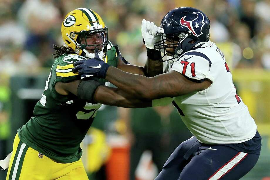 Tytus Howard (71) of the Houston Texans blocks against Rashan Gary (52) of the Green Bay Packers in the second quarter during a preseason game at Lambeau Field on August 8, 2019 in Green Bay, Wisconsin. Photo: Dylan Buell, Stringer / Getty Images / 2019 Getty Images