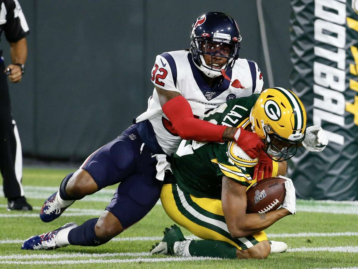 Green Bay Packers wide receiver Allen Lazard (13) pulls down a touchdown reception against Houston Texans defensive back Lonnie Johnson, Jr., (32) during a preseason NFL football game at Lambeau Field in Thursday, Aug. 8, 2019, in Green Bay, Wis.