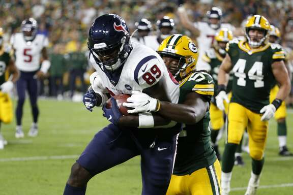 Houston Texans tight end Jerell Adams (89) hauls in a touchdown reception during the second half of a preseason NFL football game against the Green Bay Packers from the bench at Lambeau Field in Thursday, Aug. 8, 2019, in Green Bay, Wis.