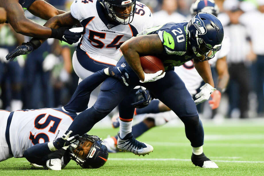 SEATTLE, WASHINGTON - AUGUST 08: Rashaad Penny #20 of the Seattle Seahawks breaks away from Malik Reed #59 of the Denver Broncos during the preseason game at CenturyLink Field on August 08, 2019 in Seattle, Washington. (Photo by Alika Jenner/Getty Images) Photo: Alika Jenner/Getty Images / 2019 Getty Images