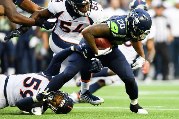 SEATTLE, WASHINGTON - AUGUST 08: Rashaad Penny #20 of the Seattle Seahawks breaks away from Malik Reed #59 of the Denver Broncos during the preseason game at CenturyLink Field on August 08, 2019 in Seattle, Washington. (Photo by Alika Jenner/Getty Images)