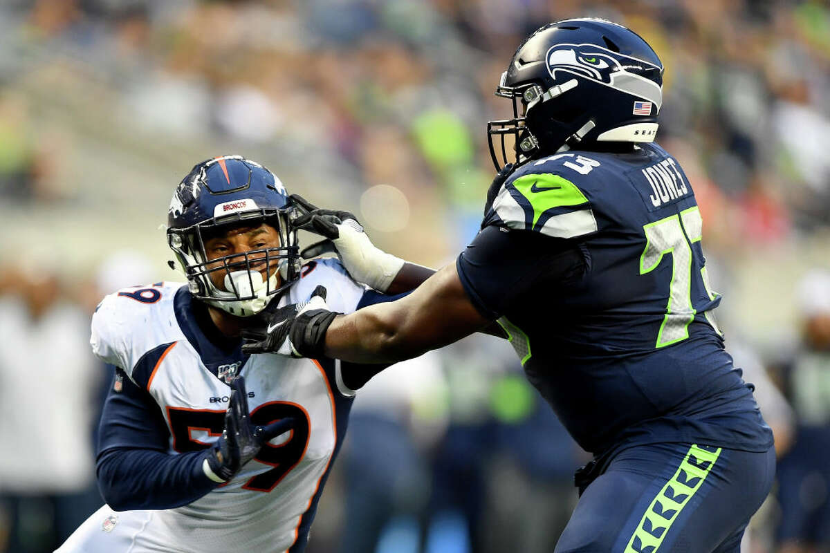 SEATTLE, WASHINGTON - AUGUST 08: Malik Reed #59 of the Denver Broncos attacks Jamarco Jones #73 of the Seattle Seahawks during the first half of the preseason game at CenturyLink Field on August 08, 2019 in Seattle, Washington. (Photo by Alika Jenner/Getty Images)
