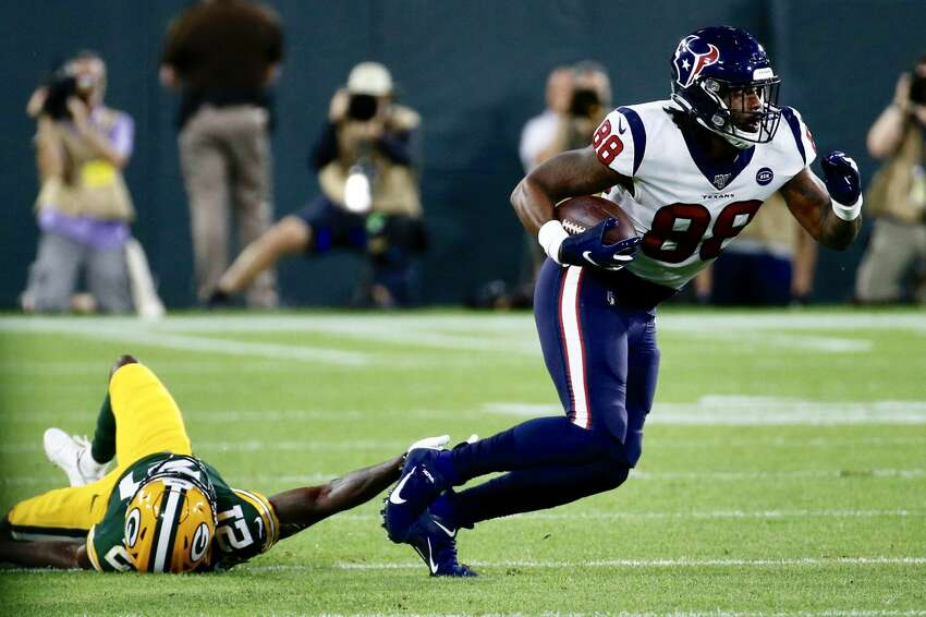 Houston Texans tight end Jordan Jordan Akins (88) breaks away from Green Bay Packers safety Natrell Jamerson (21) during a preseason NFL football game at Lambeau Field in Thursday, Aug. 8, 2019, in Green Bay, Wis.
