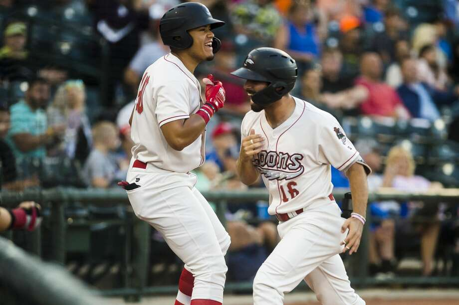 Great Lakes Loons third baseman Luke Heyer, right, high-fives right fielder Romer Cuadrado, left, after hitting a home run during a game against the Lake County Captains on Thursday, Aug. 8, 2019 at Dow Diamond. (Katy Kildee/kkildee@mdn.net) Photo: (Katy Kildee/kkildee@mdn.net)
