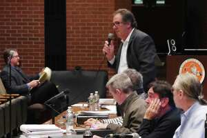 Zoning commissioner Joe Fossi speaks at a recent public hearing.