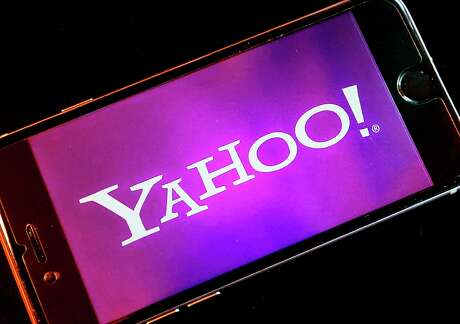 Yahoo logo appears on a smartphone.