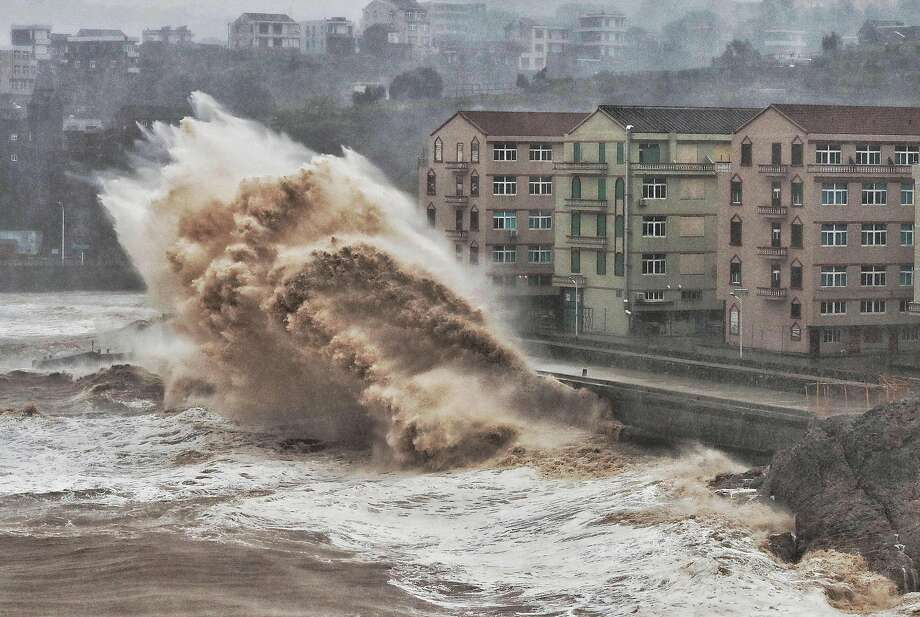 Waves smash into a sea wall in Taizhou in Zhejiang province ahead of the arrival of Typhoon Lekima. Photo: AFP / Getty Images