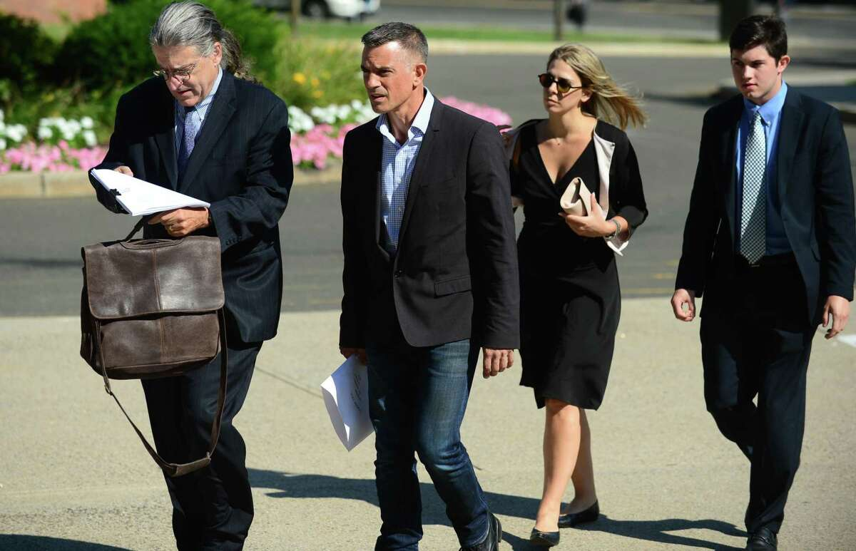 Fotis Dulos enters the Stamford courthouse Friday morning with his attorneys.