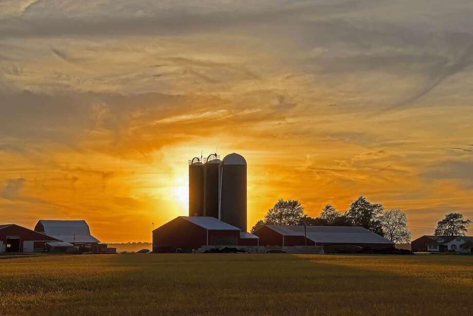 Summer is a time for warm temperatures and pleasant evenings, as seen in this recent sunset over a farm near Caseville. Photo: Bill Diller/For The Tribune