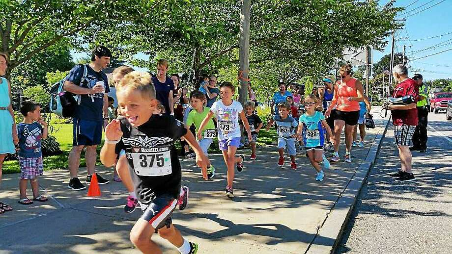 FILE - Photos from the44th annual five-mile Torrington Road Race Photo: N.F. Ambery