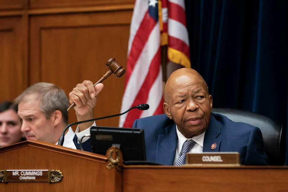 House Oversight and Reform Committee Chairman Elijah E. Cummings, D-Md., joined at left by Rep. Jim Jordan, R-Ohio, the ranking member, considers whether to hold Attorney General William Barr and Commerce Secretary Wilbur Ross in contempt for failing to turn over subpoenaed documents related to the Trump administration's decision to add a citizenship question to the 2020 census, on Capitol Hill in Washington, Wednesday, June 12, 2019. (AP Photo/J. Scott Applewhite) Photo: J. Scott Applewhite / Associated Press / Copyright 2019 The Associated Press. All rights reserved.
