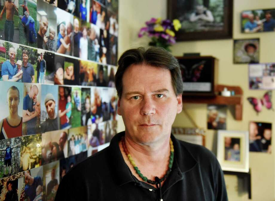 Scott Desnoyers stands next to a memorial for his late son, Danny, on Thursday, Aug. 8, 2019, at his home in Stillwater, N.Y. Danny took his own life in April. He had been battling depression and suicidal thoughts that his father says worsened when he lost his insurance and ability to afford antidepressants. (Will Waldron/Times Union) Photo: Will Waldron, Albany Times Union / 20047612A
