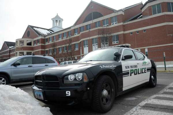 A New Milford police car is parked outside New Milford High School in New Milford, Conn. Tuesday, March 4, 2014.