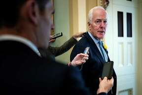 """Sen. John Cornyn (R-Texas) speaks to reporters on his way to a Senate Republican policy luncheon on Capitol Hill in Washington, June 4, 2019. Republican senators sent the White House a sharp message on Tuesday, warning that they were opposed to President Donald Trump's plans to impose tariffs on Mexican imports, just hours after the president said lawmakers would be """"foolish"""" to try to stop him. """"We're holding a gun to our own heads by doing this,"""" said Corny. (Erin Schaff/The New York Times)"""