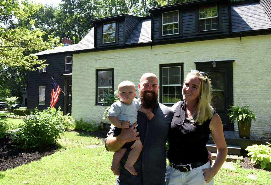 Travis and Elizabeth Martin stand outside their historic home with son, Hudson, on Tuesday, July 30, 2019, on Jordan Road in North Greenbush, N.Y. (Will Waldron/Times Union) Photo: Will Waldron / 40047498A