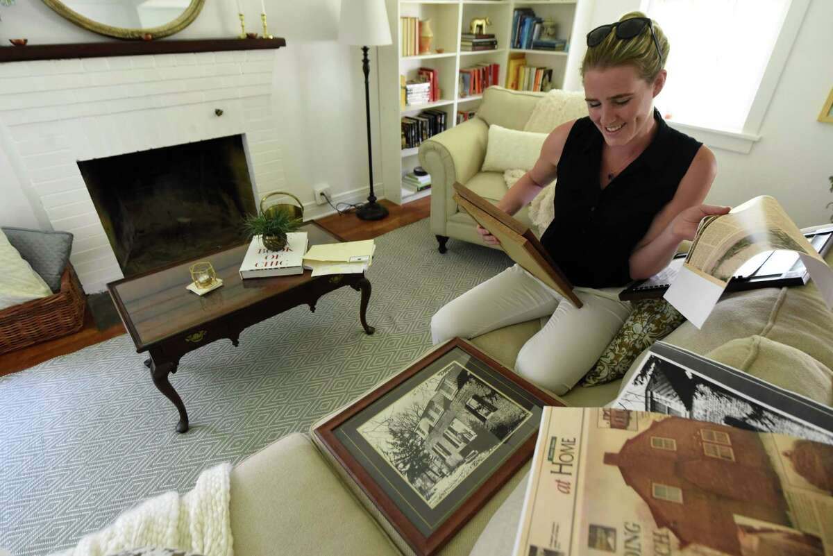 Elizabeth Martin has a collection of photos and news stories about her historic home on Tuesday, July 30, 2019, on Jordan Road in North Greenbush, N.Y. (Will Waldron/Times Union)