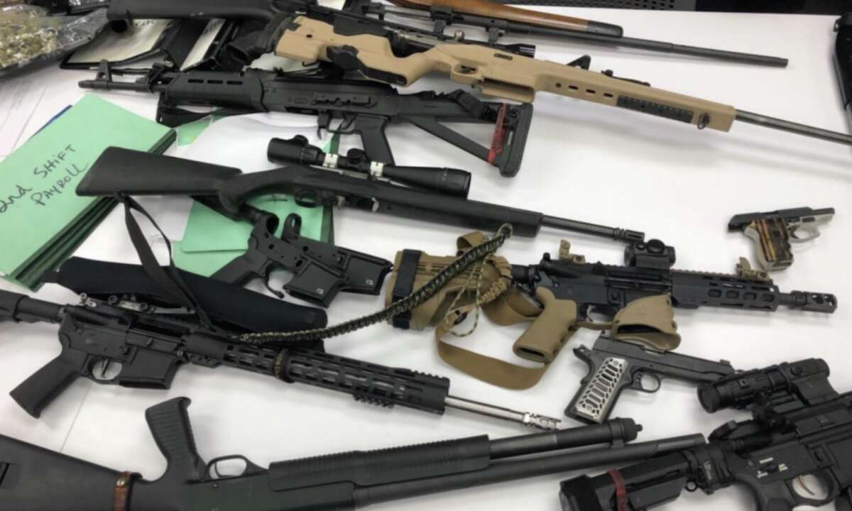 Deputies with the Harris County Sheriff's Office seized 19 guns and 8 ounces of marijuana after reports of gunfire in the Langham Creek area on Thursday, Aug. 8, 2019.