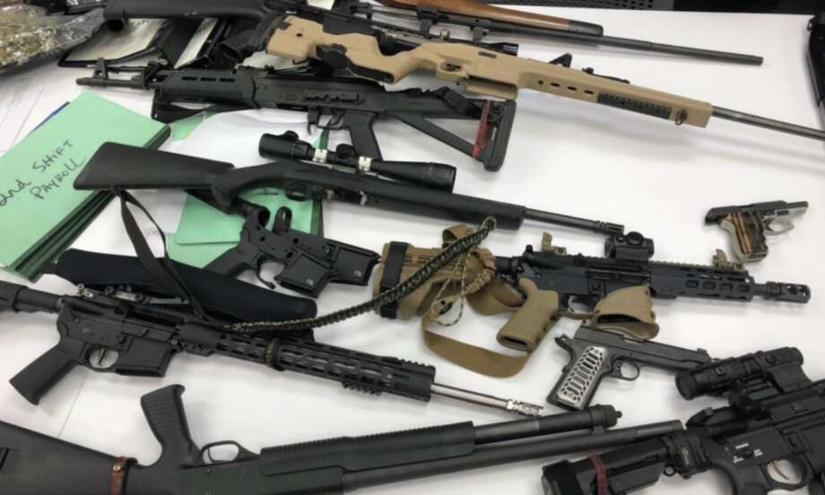 Deputies with the Harris County Sheriff's Office seized 19 guns and 8 ounces of marijuana after reports of gunfire in the Langham Creek area on Thursday, Aug. 8, 2019. Photo: Major Mike Lee / Harris County Sheriff's Office