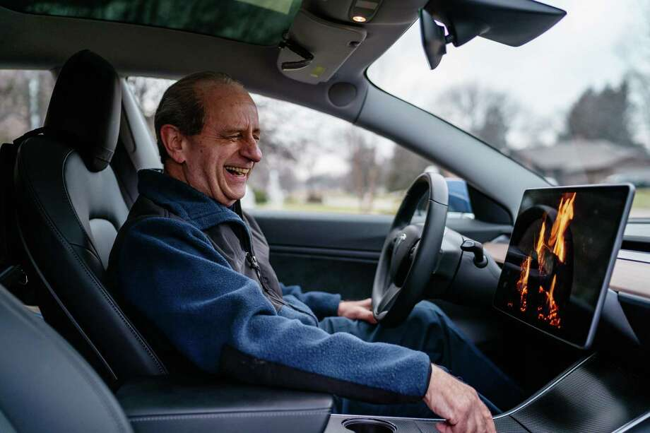"Mitch Mallin in his Tesla Model 3, with its touch screen on ""Romance Mode,"" in Farmington Hill, Mich., Dec. 27, 2018. Photo: ROZETTE RAGO, STR / NYT / NYTNS"