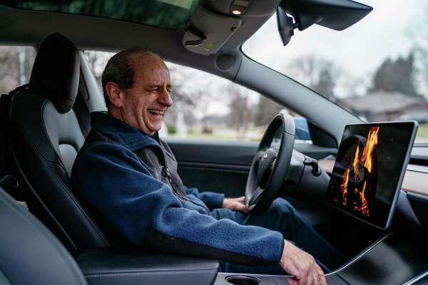 "Mitch Mallin in his Tesla Model 3, with its touch screen on ""Romance Mode,"" in Farmington Hill, Mich., Dec. 27, 2018."