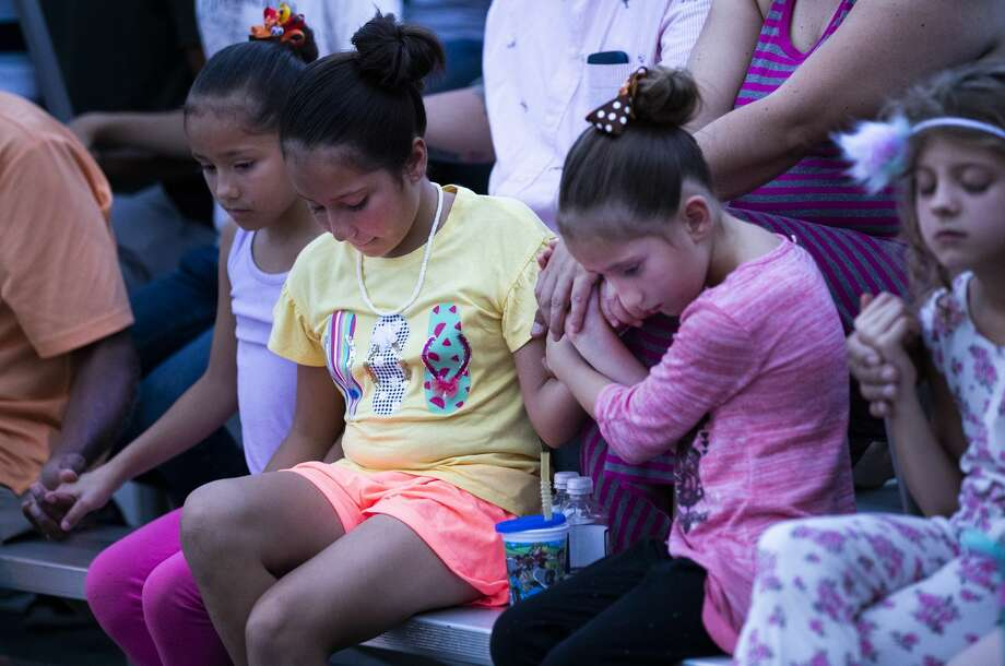 A group of girls hold hands during a prayer service in memory of the victims of the El Paso shooting. The event was organized by the Immanuel Church. Photo: Marie D. De Jesús/Staff Photographer