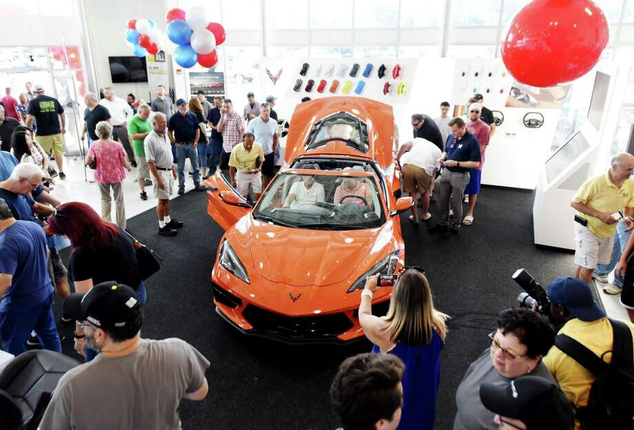 Auto enthusiasts flocked to DePaula Chevrolet to see the new 2020 Corvette during an unveiling event on Friday, Aug. 9, 2019, in Albany, N.Y. The popular American sports car underwent and extensive redesign when Chevrolet opted for a mid-engine configuration. (Will Waldron/Times Union) Photo: Will Waldron, Albany Times Union / 40047623A